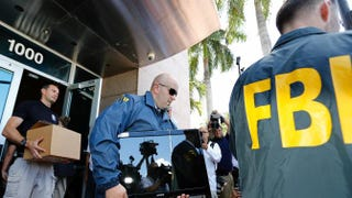 FBI agents carry boxes and computers from the headquarters of the Confederation of North, Central American and Caribbean Association Football after it was raided on May 27, 2015, in Miami Beach. The raid is part of an international investigation of FIFA, the international soccer governing body.Joe Skipper/Getty Images