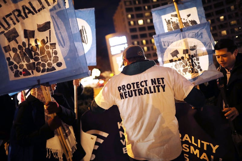 About 60 demonstrators gather outside the 31st Annual Chairman's Dinner to show their support for net neutrality at the Washington Hilton on Dec. 7, 2017, in Washington, D.C. (Chip Somodevilla/Getty Images)