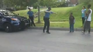 Officer Krebs busting a move with a group of kids in Kansas City, Mo., Aug. 10, 2014.YouTube screenshot