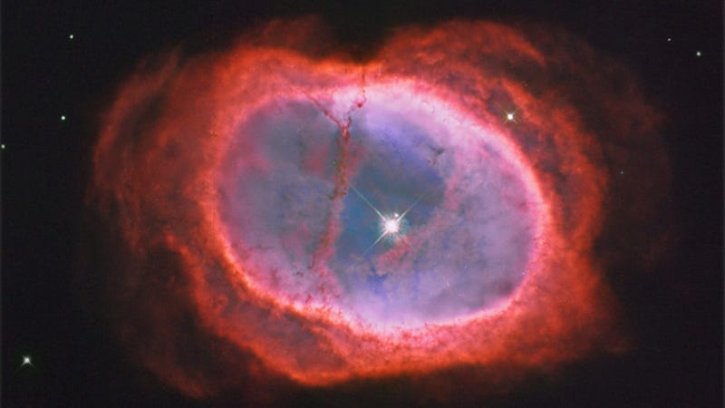 Illustration for article titled A star steals its partner's spotlight in the Southern Ring Nebula