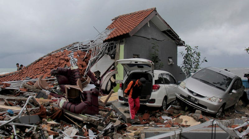 A man inspects the damage suffered by a building following a tsunami in Anyar, Indonesia, Sunday, Dec. 23, 2018.