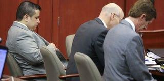 George Zimmerman and lawyers at pretrial hearing (Joe Burbank-Pool/Getty Images)