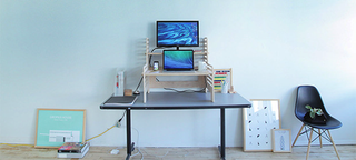 Illustration for article titled This Clever Contraption Turns Any Table Into a Standing Desk