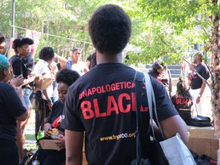 A young man stands, listening to organizers with Black Youth Project 100, on the campus of Cleveland State University during the Movement for Black Lives Convening on July 24, 2015.Danielle Belton/The Root