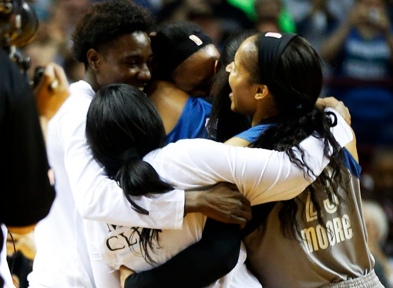 Minnesota Lynx player Maya Moore (right) and teammates celebrate after they win the WNBA Finals championship on Oct. 4, 2017, in Minneapolis. (Jim Mone/AP Images)