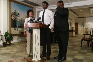 Karsiah Duncan (center), the son of Thomas Eric Duncan, speaks to the media at the Wilshire Baptist Church Oct. 7, 2014, in Dallas.Joe Raedle/Getty Images