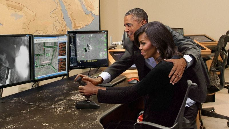 Illustration for article titled Obama Gently Guides Michelle's Hand As She Maneuvers Drone Joystick