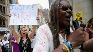 A small and peaceful group of demonstrators gather to protest in front of the Baltimore City Circuit Courthouse East Sept. 2, 2015, where pretrial hearings will be held for six police officers charged in the death of Freddie Gray, a 25-year-old man who suffered a severe spinal cord injury while in police custody after being arrested.Chip Somodevilla/Getty Images