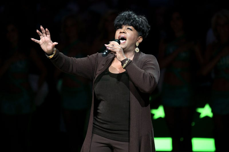 Anita Baker sings the national anthem before Game 4 of the 2010 NBA Finals between the Los Angeles Lakers and the Boston Celtics on June 10, 2010, at TD Garden in Boston. (Elsa/Getty Images)