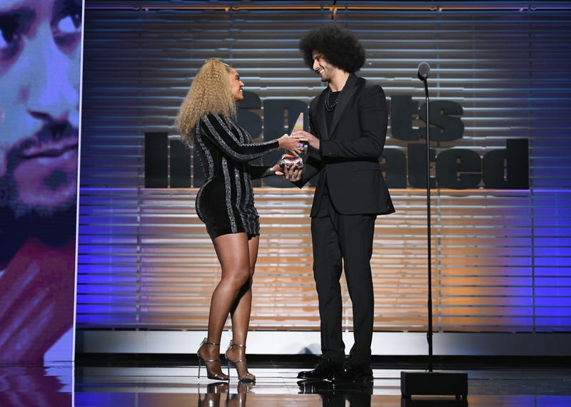 Colin Kaepernick accepts the Sports Illustrated Muhammad Ali Legacy Award from Beyoncé during the magazine's 2017 Sportsperson of the Year show Dec. 5, 2017, at the Barclays Center in New York City. (Slaven Vlasic/Getty Images for Sports Illustrated)