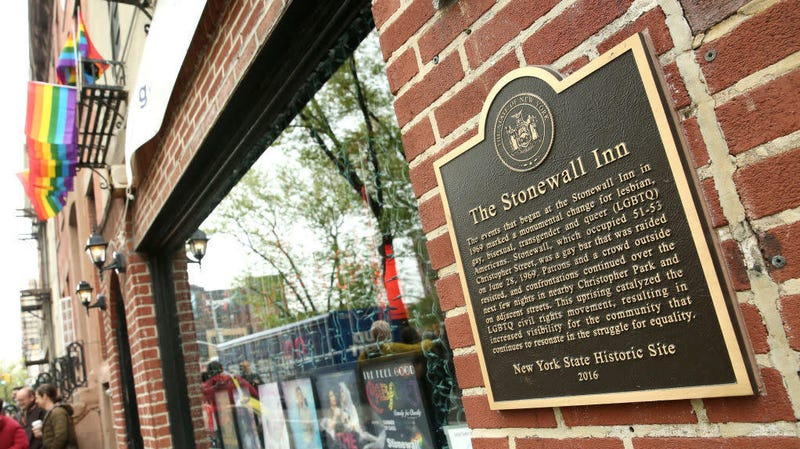 Plaque on New York City's historic Stonewall Inn outlines its landmark status as a key element in the history of gay rights