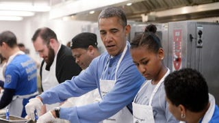President Barack Obama and daughter Sasha participate in a community-service project at the D.C Central Kitchen in Washington, D.C., in celebration of the Martin Luther King Jr. Day of Service, Jan. 20, 2014.Olivier Douliery-Pool/Getty Images