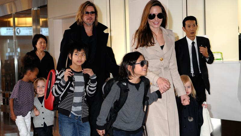 Illustration for article titled Angelina, Brad & Chicly Color-Coordinated Brood Arrive In Japan