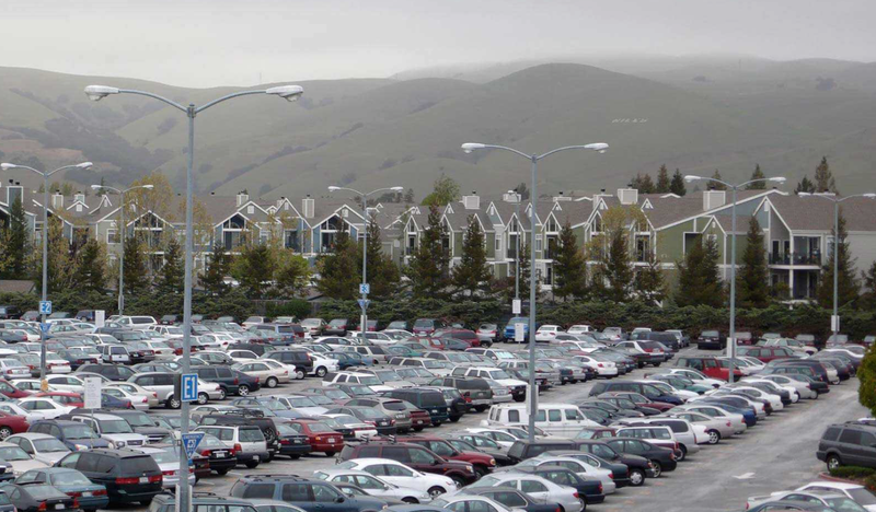 Surface parking lots, even at transit stops, are choking San Francisco. (Image: SFMTA)