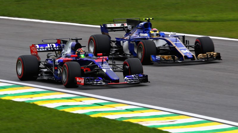 A Toro Rosso F1 car, which will suffer under Honda in 2018, and a Sauber F1 car, which barely missed that misery thanks to its new team boss. Photo credit: Clive Mason/Getty Images