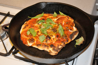 "Illustration for article titled Cast-Iron Skillet the Key to ""Serious"" Homemade Pizza"