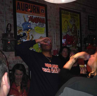 "Illustration for article titled Charles Barkley Pounding Shots In A ""Good Luck, Coach Saban"" Shirt"