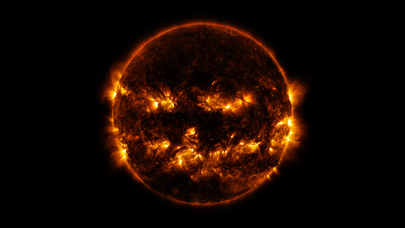 NASA image from October 8th, 2014 show active regions on the Sun that give it a very jack-o'-lantern-like appearance. (Image: NASA/GSFC/SDO)