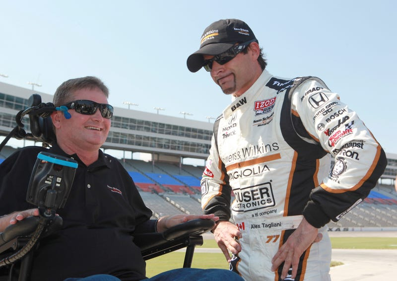Verizon IndyCar Series team owner Sam Schmidt with driver Alex Tagliani, pictured during qualifying at the Firestone Twin 275 at Texas Motor Speedway in 2011. Photo credit: AP Images/Jeffery Washington