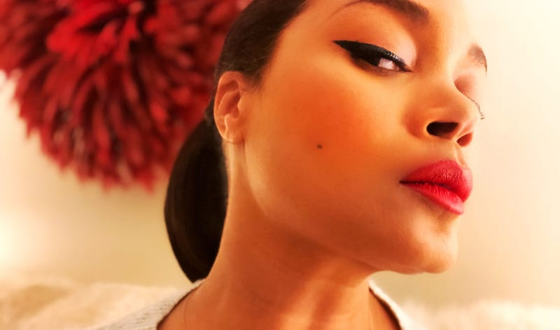A red statement lip and a cateye? Instant classic.