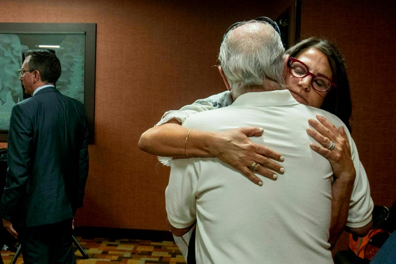 Tanya Gersh hugs her father after the hearing on July 11.