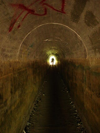 Illustration for article titled to heaven, to hell: the end of the tunnel is that-a-way, man.