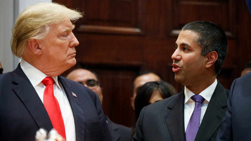 President Donald Trump talks with Ajit Pai, Chairman of the Federal Communications Commission, during a Diwali ceremonial lighting of the Diya in the Roosevelt Room of the White House, Tuesday, Nov. 13, 2018, in Washington.