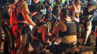 Demonstrators are arrested by police during an act of civil disobedience Aug. 10, 2015, on West Florissant Avenue in Ferguson, Mo. Michael B. Thomas/Getty Images