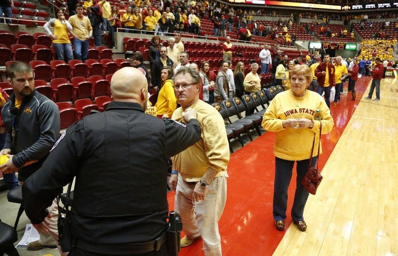 Illustration for article titled After Loss To Kansas, Angry Iowa State Fan Rushes Court, Tries To Confront Bill Self