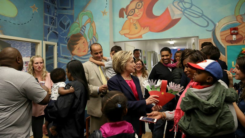 Democratic presidential candidate and former U.S. Secretary of State Hillary Clinton greets students and parents while touring a KinderCare daycare center May 9, 2016 in Fairfax, Virginia. Photo via Getty Images.