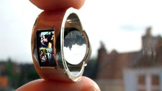 Illustration for article titled Projector Wedding Ring Will Make You Look Highly Unromantic by Comparison