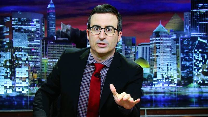 Illustration for article titled John Oliver Just Won The Internet When He Stopped His Heart On Live TV To Confront Alfred Hitchcock In Hell About His Sexual Harassment Allegations