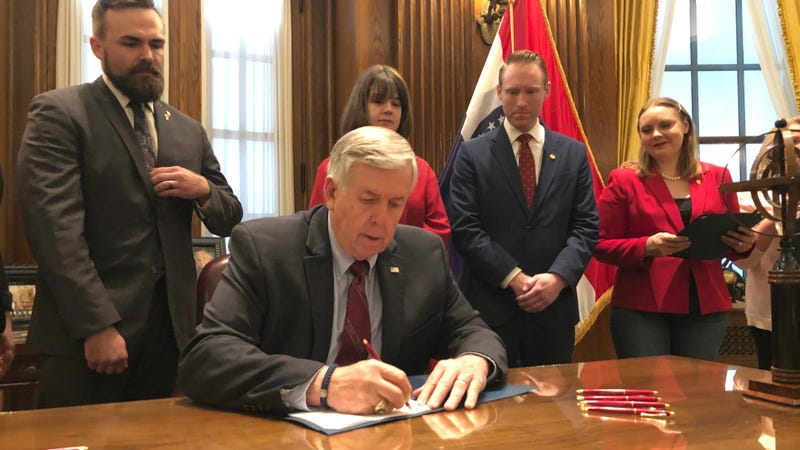 Missouri Republican Governor Mike Parson signing an eight-week abortion ban on May 24, 2019.