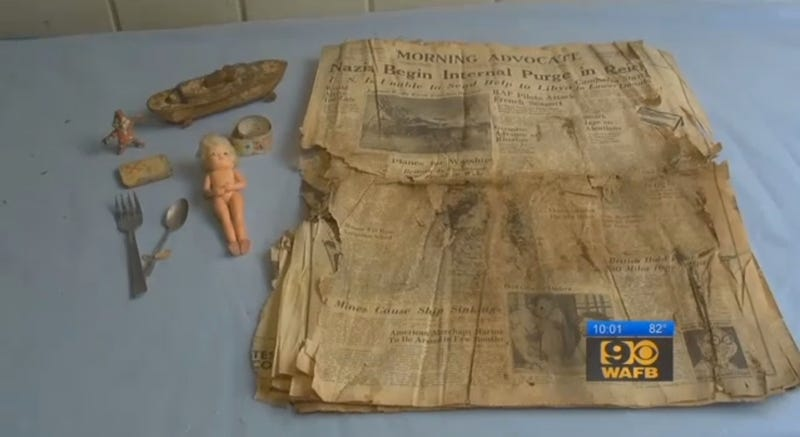 The contents of a time capsule from 1942, including a mysterious object that might date from 1991 (screenshot from WAFB)