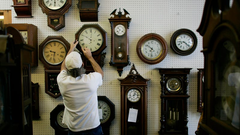 Mark Brown adjusts clocks on the wall at Brown?s Old Time Clock Shop March 6, 2007 in Plantation, Florida.