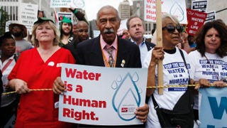 Rep. John Conyers Jr. (D-Mich.) joins demonstrators protesting the actions of the Detroit Water and Sewerage Department in Detroit on July 18, 2014.Joshua Lott/Getty Images