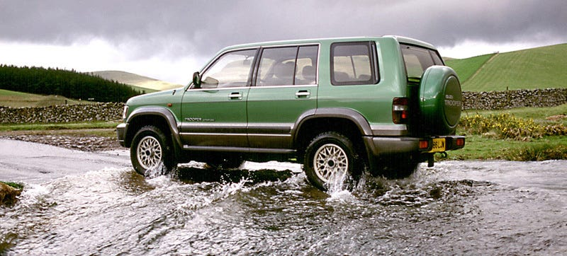Illustration for article titled Here Are Some Pictures Of An Isuzu Trooper In A Stream