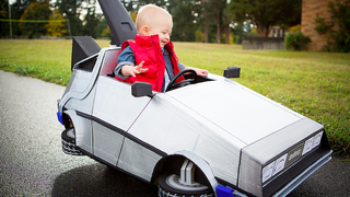 Illustration for article titled This Awesome Baby's Marty McFly Costume and DeLorean Push Car Is Absolutely Adorable