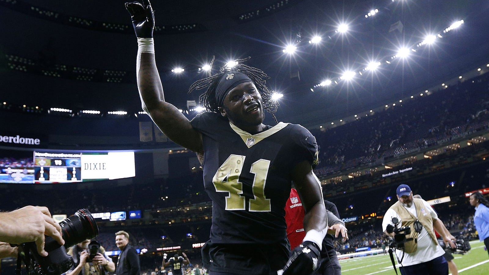 58811ba52 New Orleans Saints Running Back Alvin Kamara Wears Kaepernick Jersey and  Make  Africa Home Again  Hat