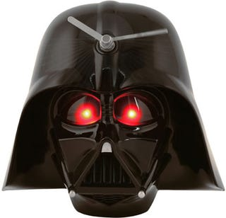 Illustration for article titled 3D Darth Vader Wall Clock Springs into Action When the Lights Go Out