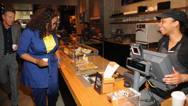 Oprah Winfrey and Starbucks CEO Howard Schultz at the Teavana Fine Teas + Tea Bar in New York.
