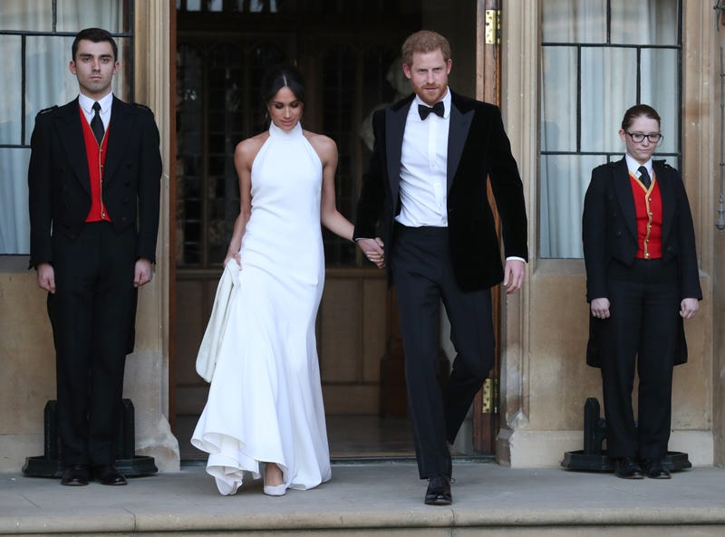 Meghan Duchess of Sussex, and Prince Harry Duke of Sussex, leave Windsor Castle after their wedding to attend an evening reception at Frogmore House on May 19, 2018 in Windsor, England.