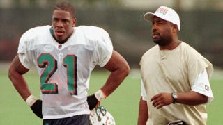 Miami Dolphins' running back Lawrence Phillips (left) in 1996RHONA WISE/AFP/Getty Images