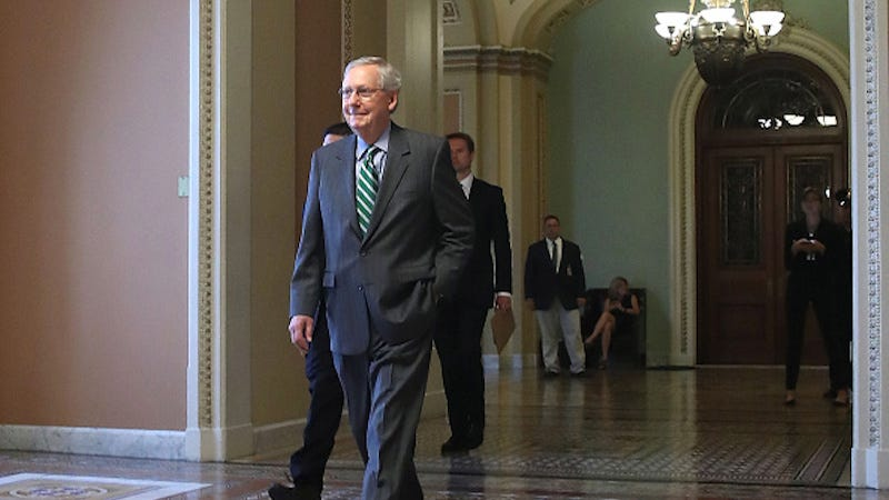 Image via Getty. Smile via McConnell's empty soul.