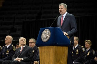 New York Mayor Bill de Blasio speaks at the New York City Police Department graduation ceremony at Madison Square Garden in New York City on Dec. 29, 2014.Andrew Burton/Getty Images