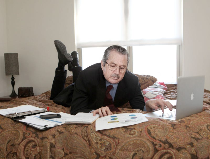 Illustration for article titled Businessman Does His Work Lying On Bed Like Schoolgirl