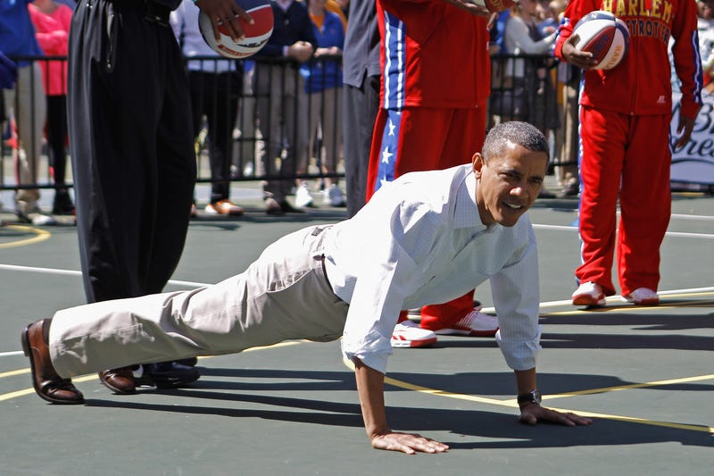 President Barack Obama does pushups during the annual Easter Egg Roll on the White House tennis court April 9, 2012, in Washington, D.C. Chip Somodevilla/Getty Images
