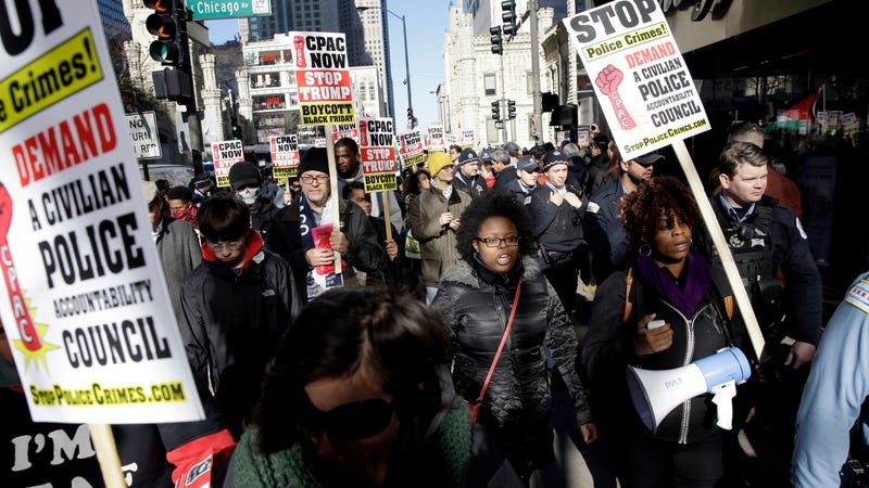 "Protesters on Michigan Ave in Chicago in a ""march for justice."" Image via AP."