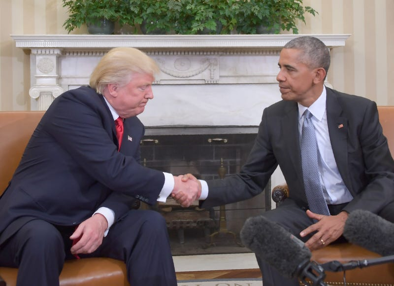 Republican President-elect Donald Trump and President Barack Obama shake hands as they meet on transition planning in the Oval Office at the White House in Washington, D.C., on Nov. 10, 2016. JIM WATSON/AFP/Getty Images