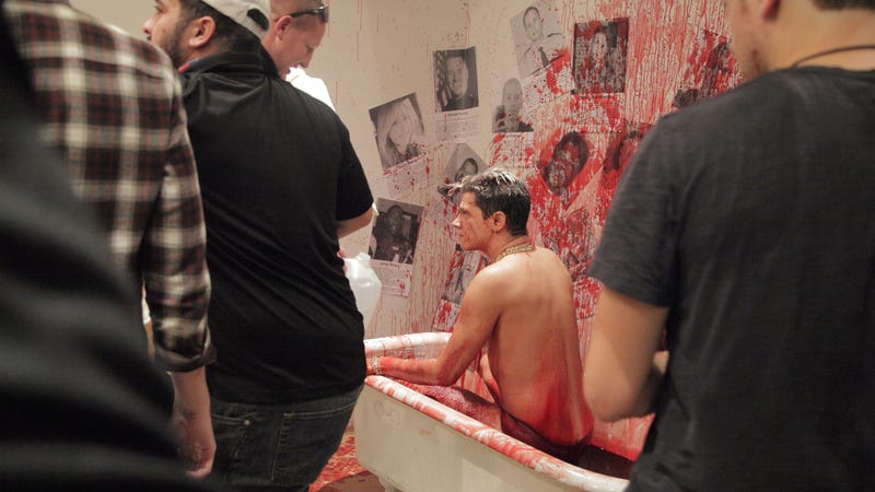 Milo Yiannopoulos in a bathtub full of pig's blood